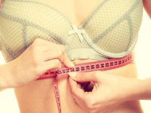 girl taking measurements for sports bra