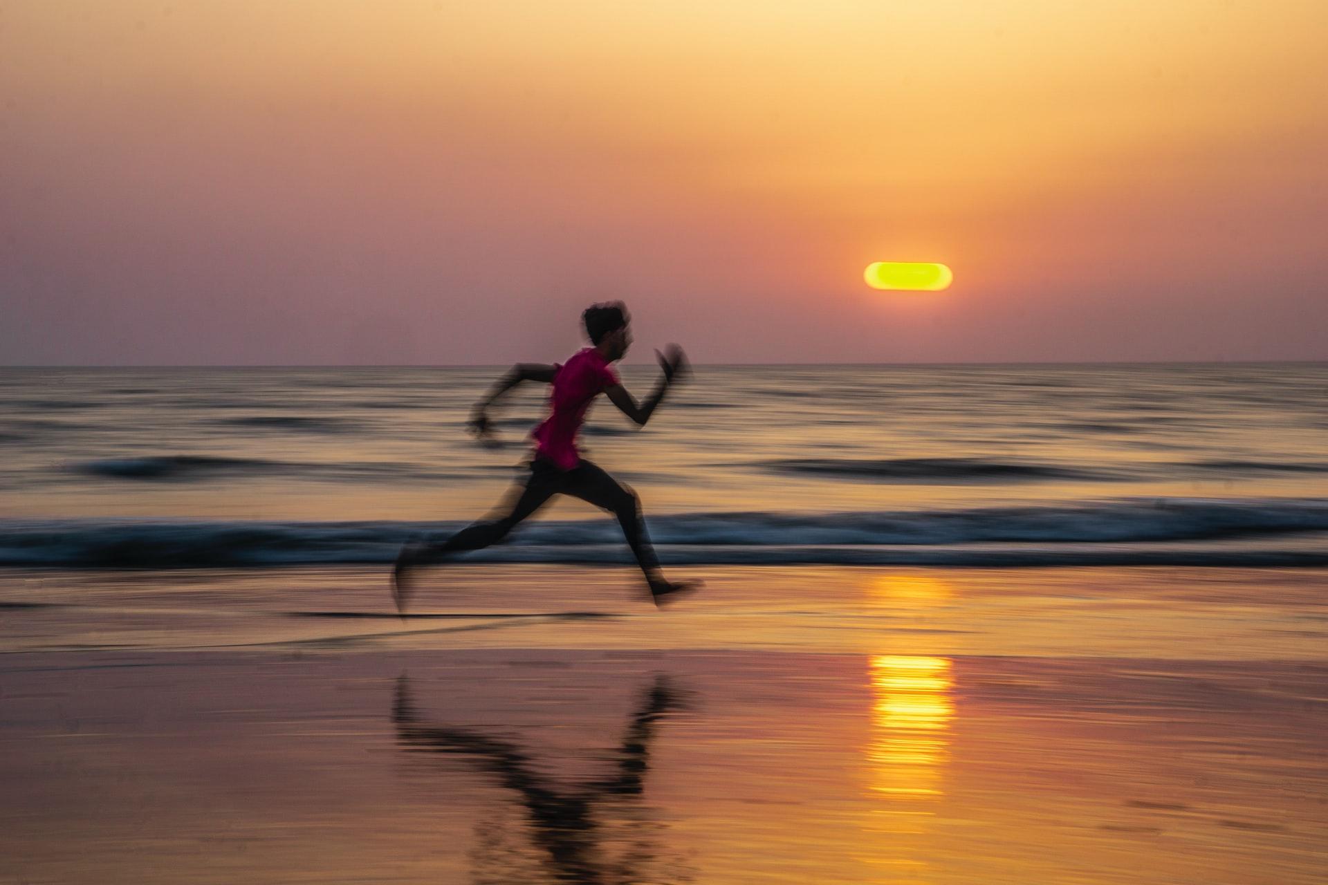 Sprinting man on a beach
