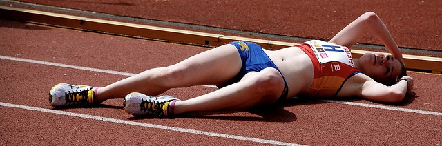 Injured fatigued female runner