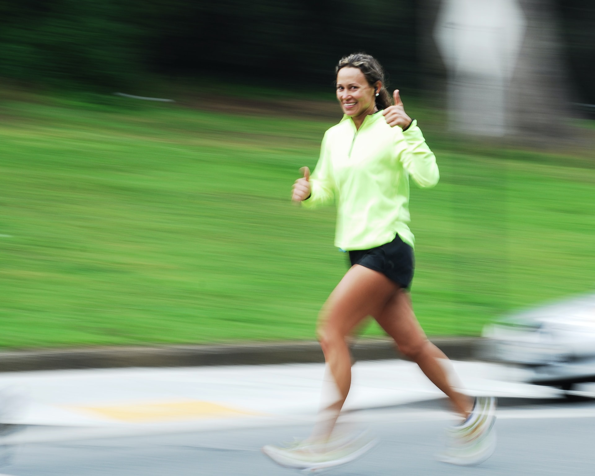 Woman running and smiling