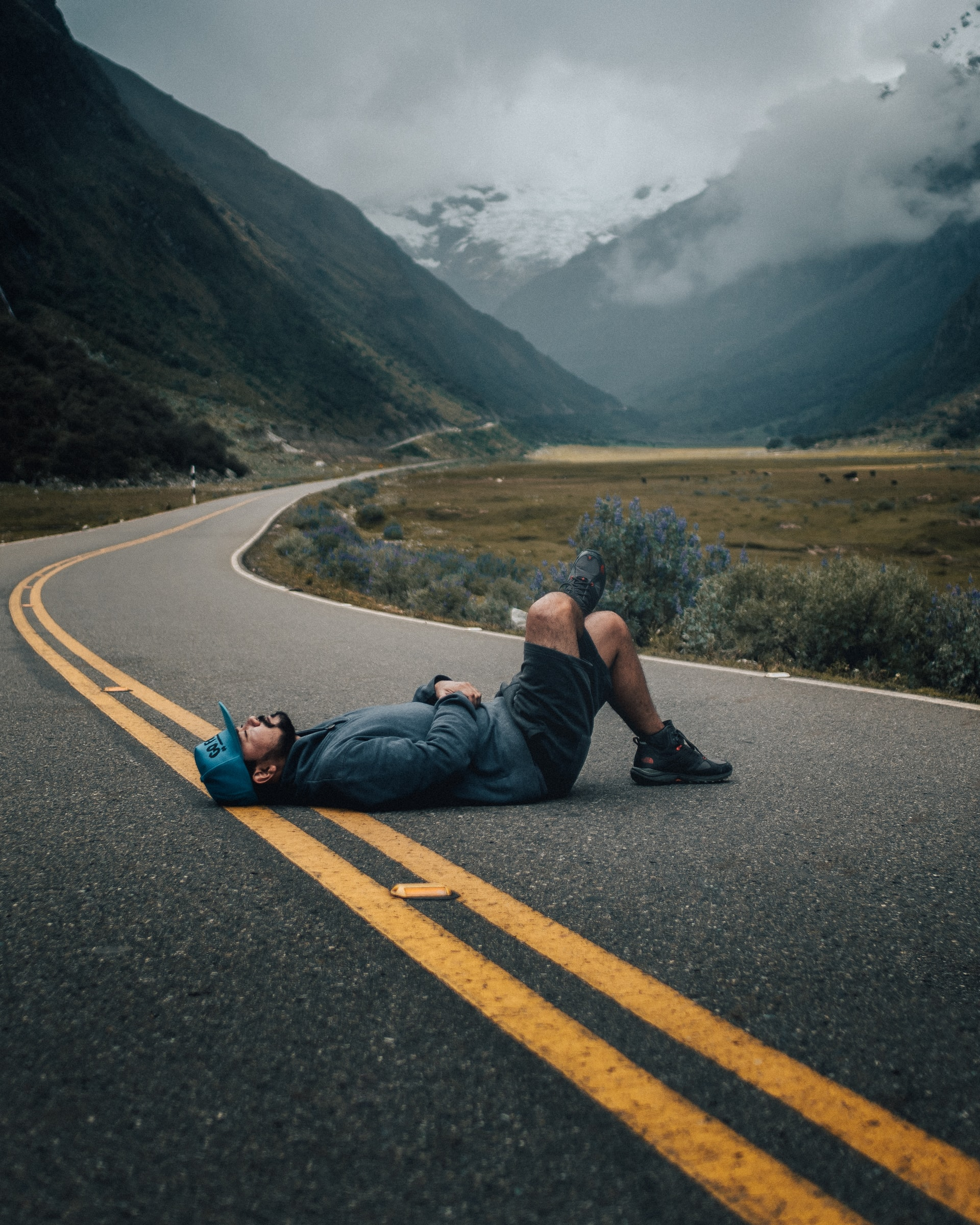 man resting in the road